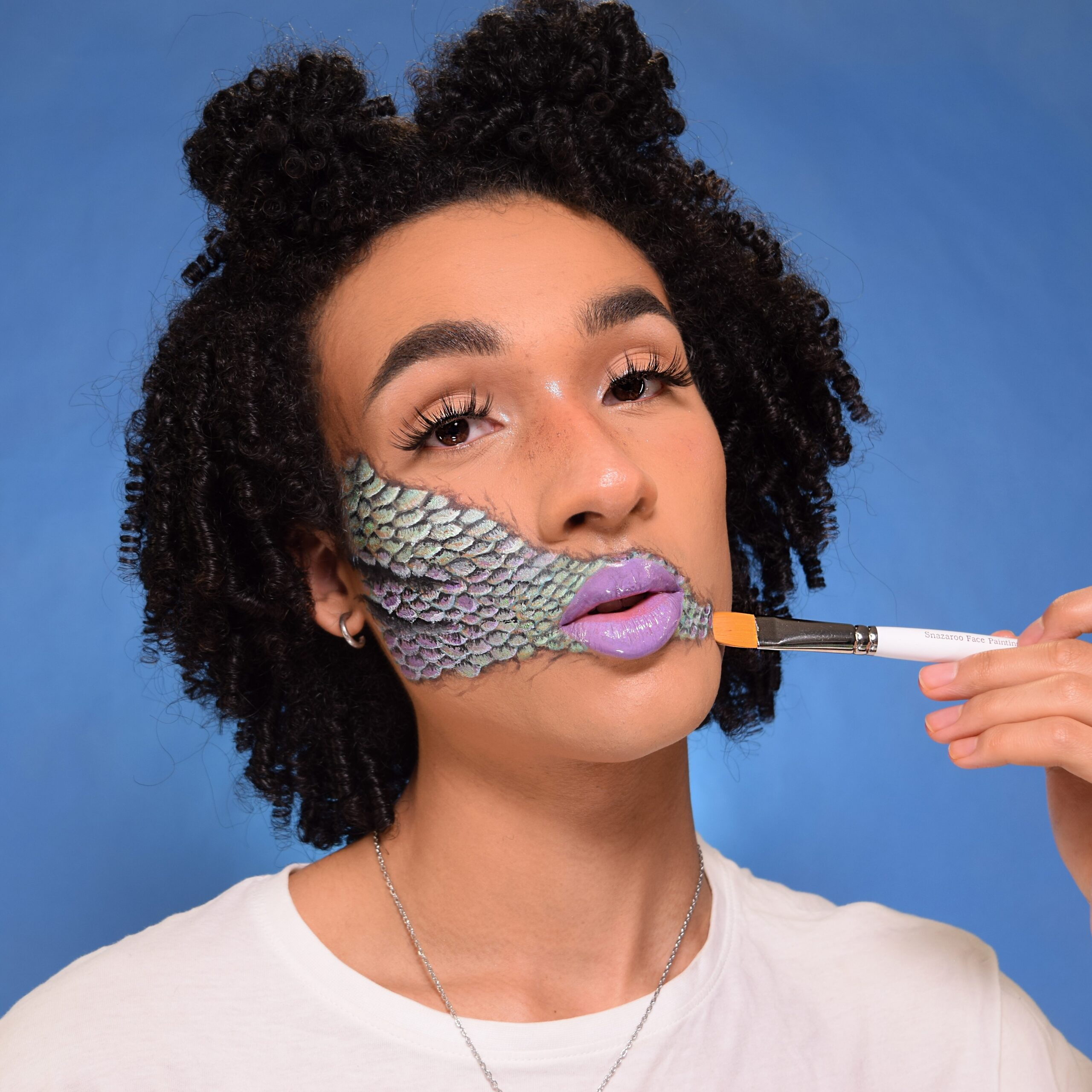 Boy with Mermaid Scales face paint design