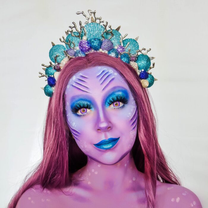 girl with Mermaid face paint design
