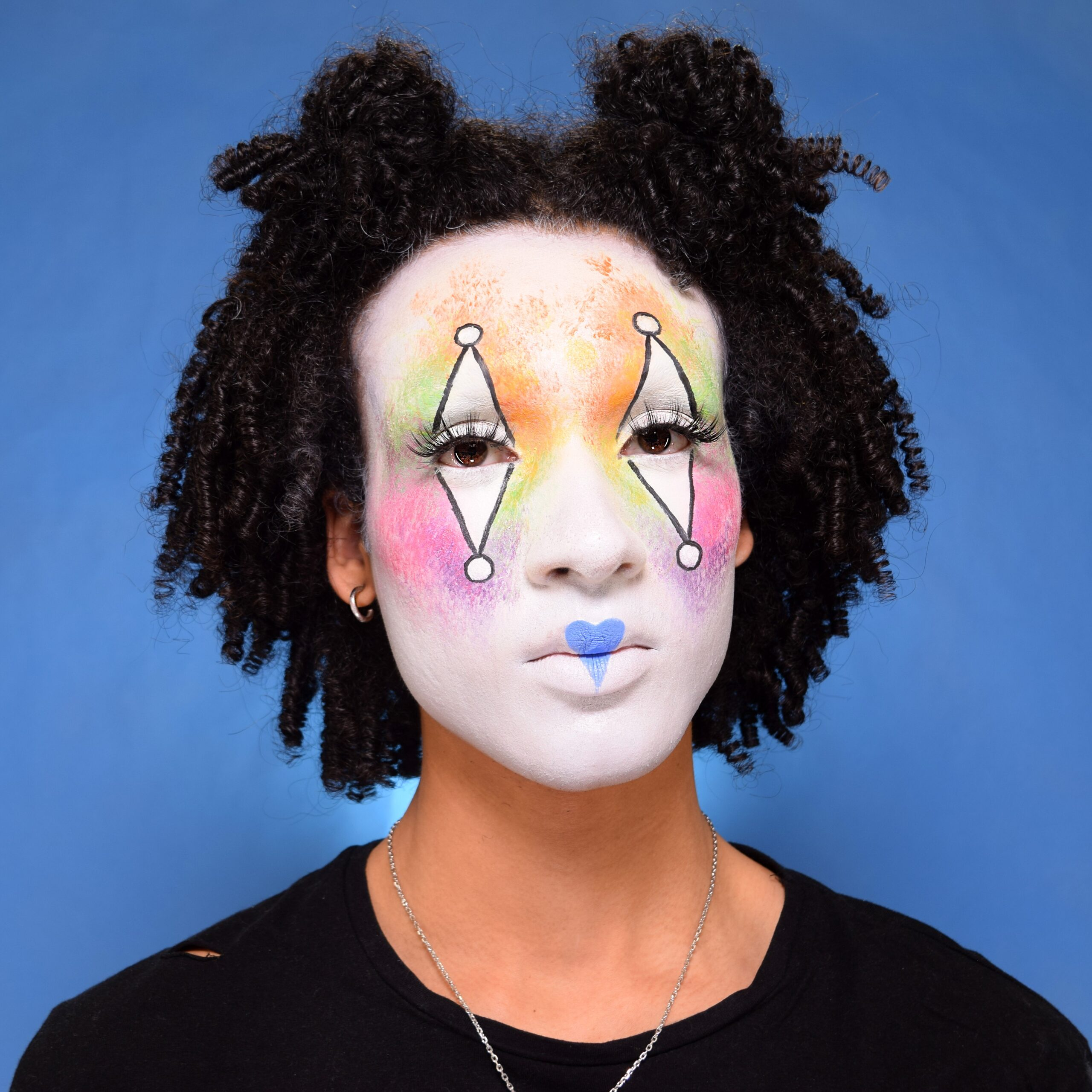 Boy with Sparkle Clown face paint design for Halloween