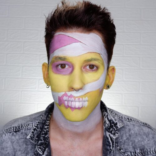 Boy with step 2 of Pop Art Zombie face paint design for Halloween