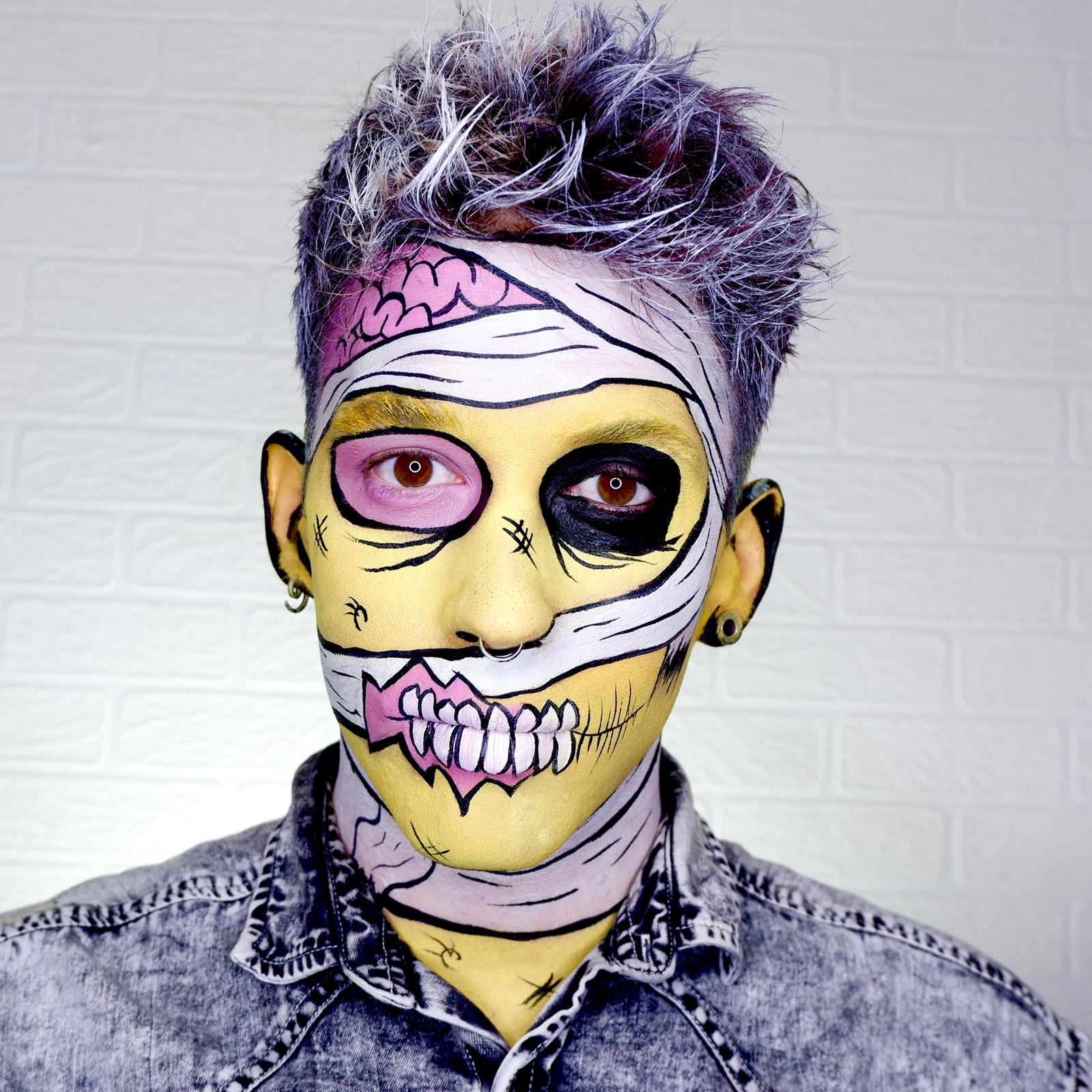 Boy with Pop Art Zombie face paint design for Halloween