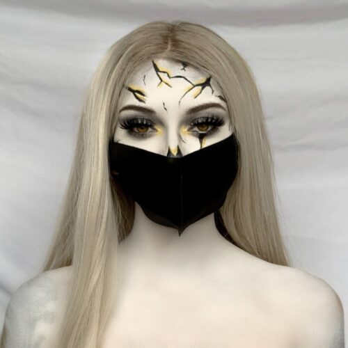 girl with Cracked Skull face paint design and mask for Halloween costumes