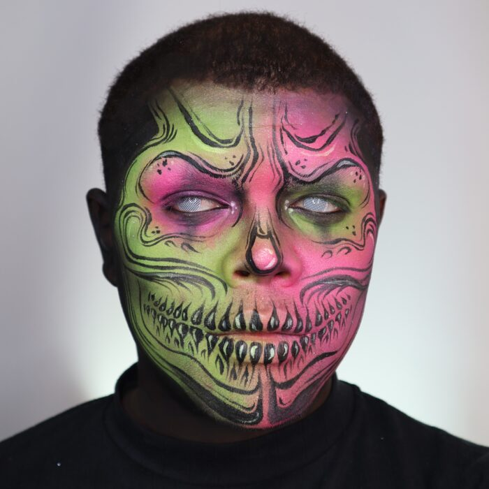 Boy with Neon Skull face paint design for Halloween