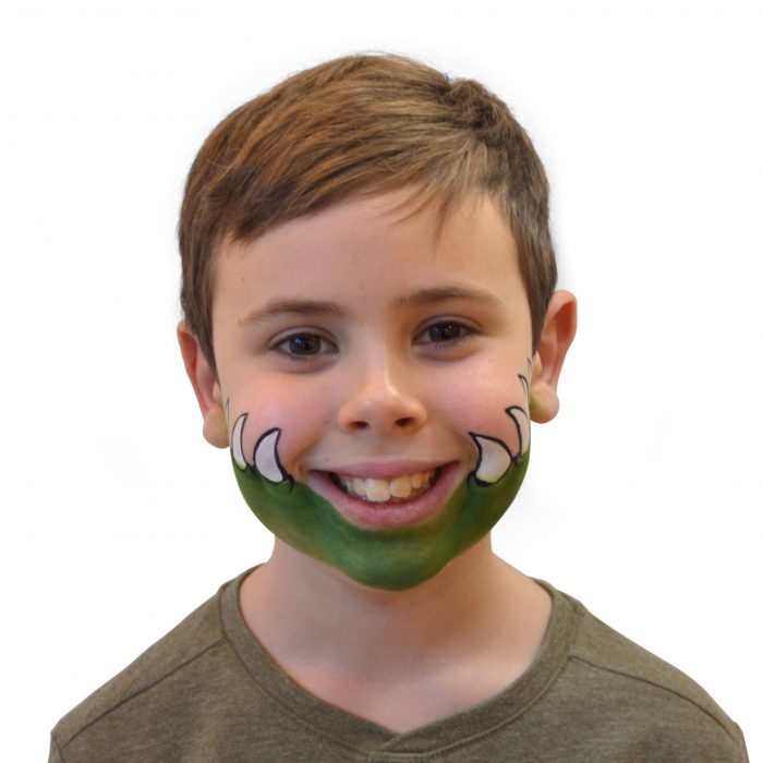 Boy with simple kids crocodile face paint. Step 3 of 3